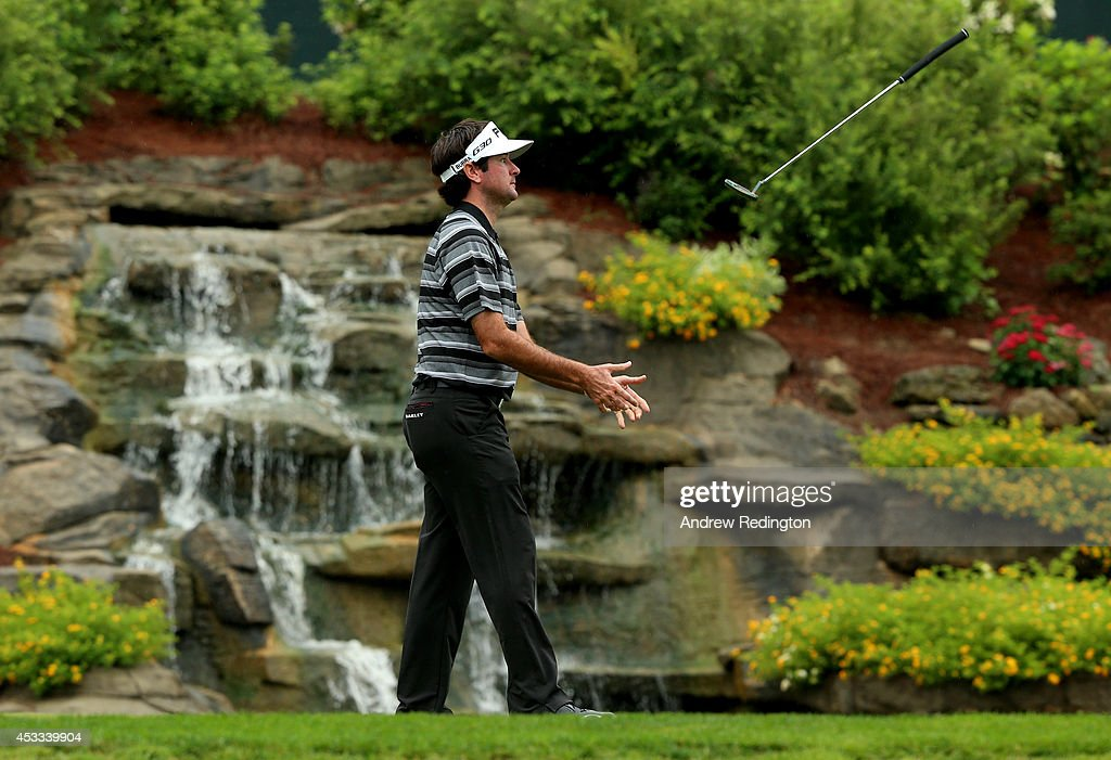 <a gi-track='captionPersonalityLinkClicked' href=/galleries/search?phrase=Bubba+Watson&family=editorial&specificpeople=597658 ng-click='$event.stopPropagation()'>Bubba Watson</a> of the United States reacts on the 13th green during the second round of the 96th PGA Championship at Valhalla Golf Club on August 8, 2014 in Louisville, Kentucky.