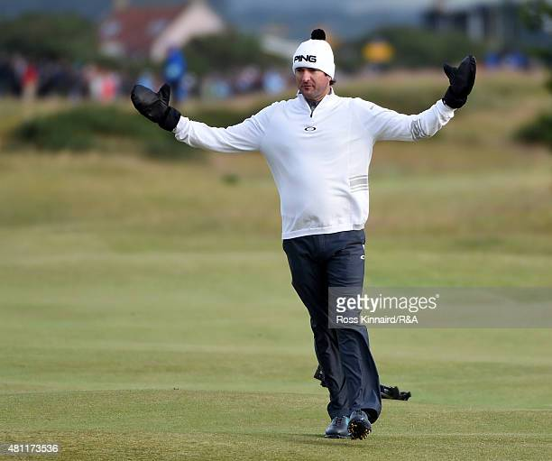 Bubba Watson of the United States reacts on the 17th fairway as play is suspended due to high winds during the second round of the 144th Open...