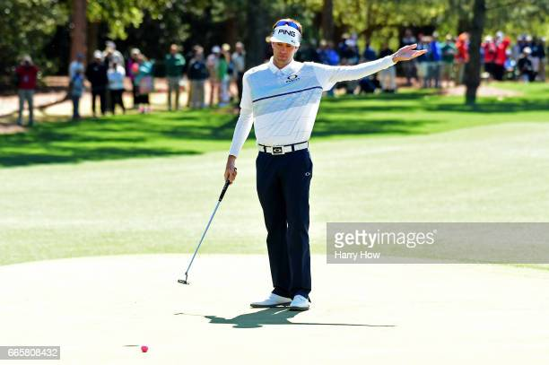 Bubba Watson of the United States reacts to a missed putt for par on the first green during the second round of the 2017 Masters Tournament at...
