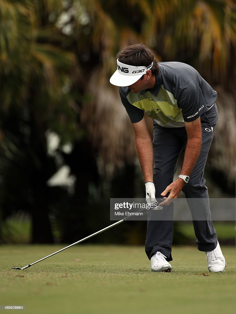 Bubba Watson of the United States reacts to his tee shot on the twelfth hole during the third round of the World Golf ChampionshipsCadillac...