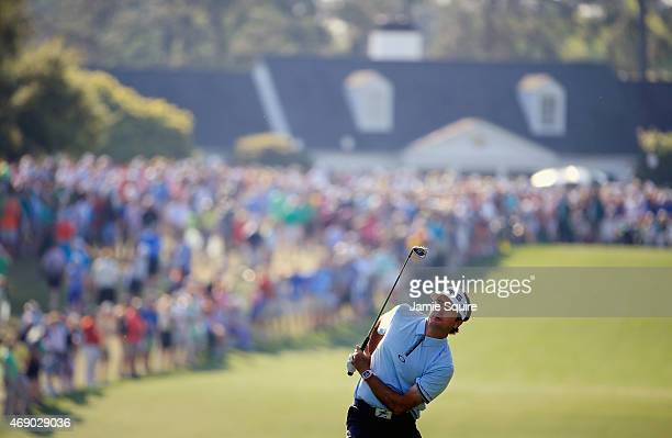 Bubba Watson of the United States watches his approach shot on the first hole during the first round of the 2015 Masters Tournament at Augusta...