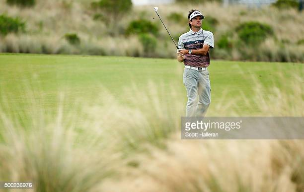 Bubba Watson of the United States watches his second shot on the tenth hole during the final round of the Hero World Challenge at Albany The Bahamas...