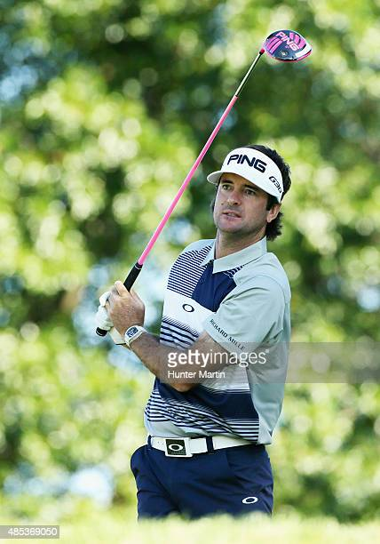 Bubba Watson of the United States watches his tee shot on the 12th hole during the first round of The Barclays at Plainfield Country Club on August...