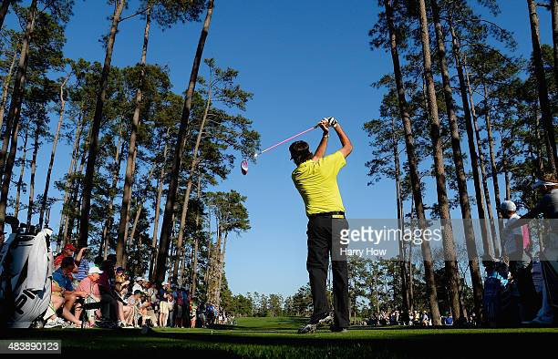 Bubba Watson of the United States watches his tee shot on the 17th hole during the first round of the 2014 Masters Tournament at Augusta National...