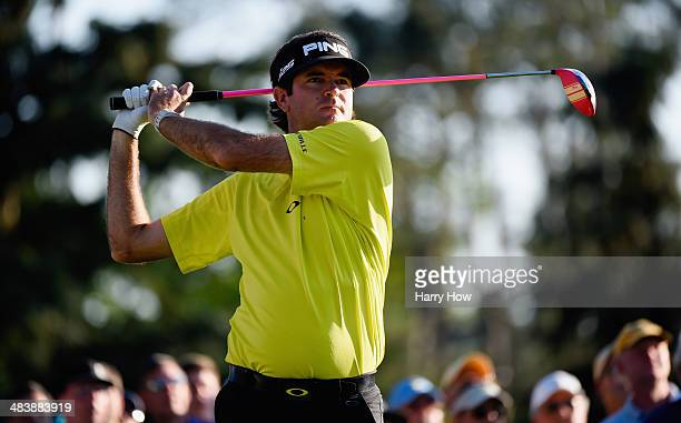 Bubba Watson of the United States watches his tee shot on the 18th hole during the first round of the 2014 Masters Tournament at Augusta National...