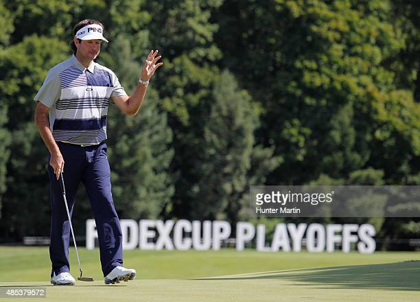Bubba Watson of the United States waves after making birdie on the 18th hole during the first round of The Barclays at Plainfield Country Club on...