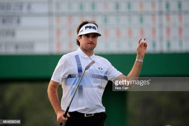 Bubba Watson of the United States waves to the gallery on the 17th green after winning the 2014 Masters Tournament by a threestroke margin at Augusta...