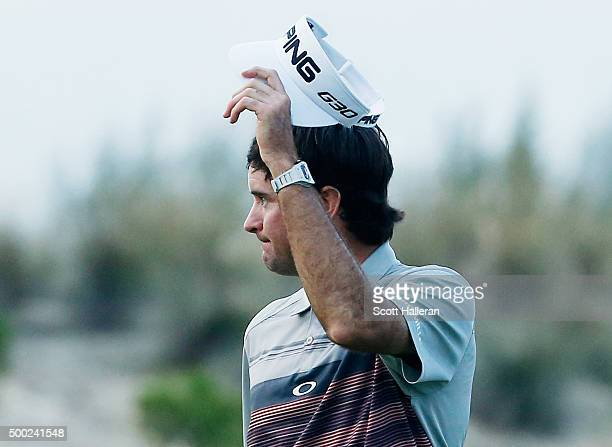 Bubba Watson of the United States waves to the gallery on the 18th green after his threestroke victory at the Hero World Challenge at Albany The...