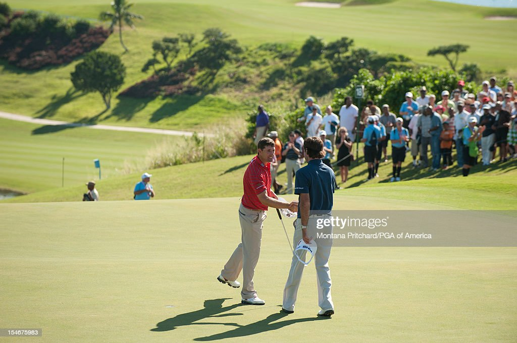 Bubba Watson (R) of the US congratulates Padraig Harrington of Ireland on his win during the final round of play at The Port Royal Golf Club for the 30th Grand Slam of Golf on October 24, 2012 in Southampton, Bermuda.