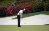 Bubba Watson of the US putts on the 13th green during the final round of the 78th Masters Golf Tournament at Augusta National Golf Club on April 13...