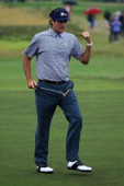 Bubba Watson of the US Team celebrates making a putt on the 14th hole during the Day Three Morning Foursome Matches of the 2011 Presidents Cup at...