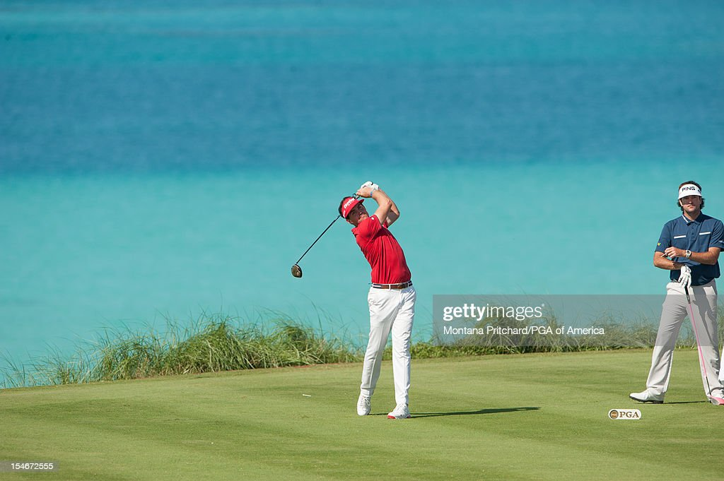 Bubba Watson (R) of the US watches as Keegan Bradley of the US makes his shot on number 9 during the final round of play at The Port Royal Golf Club for the 30th Grand Slam of Golf on October, 24, 2012 in Southampton, Bermuda.