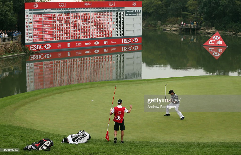 Bubba Watson of the USA and his caddie Ted Scott celebrate on the first playoff hole as he wins the WGC HSBC Champions at the Sheshan International...
