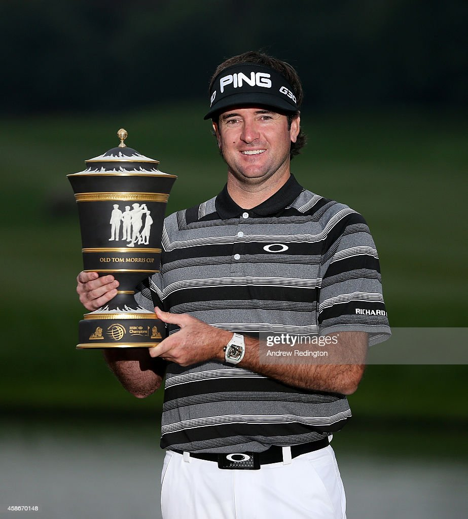 Bubba Watson of the USA poses with the trophy after winning the WGC HSBC Champions at the Sheshan International Golf Club on November 9 2014 in...