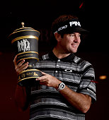Bubba Watson of the USA with the winners trophy after his victory on the first playoff hole during the final round of the WGC HSBC Champions at the...