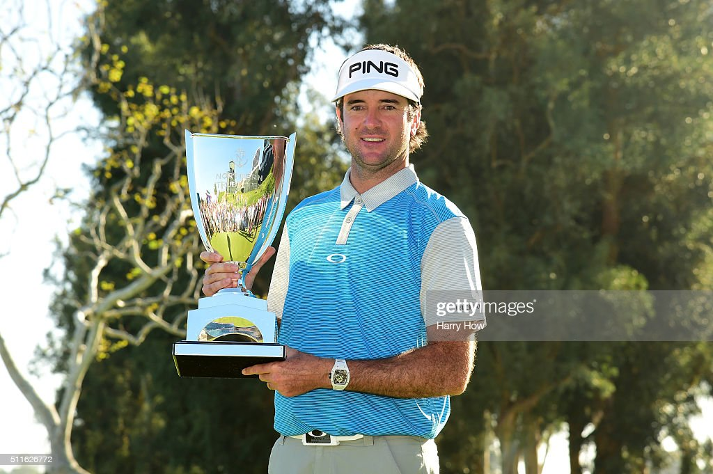 Bubba Watson poses with the trophy after putting in to win on the 18th hole during the final round of the Northern Trust Open at Riviera Country Club...