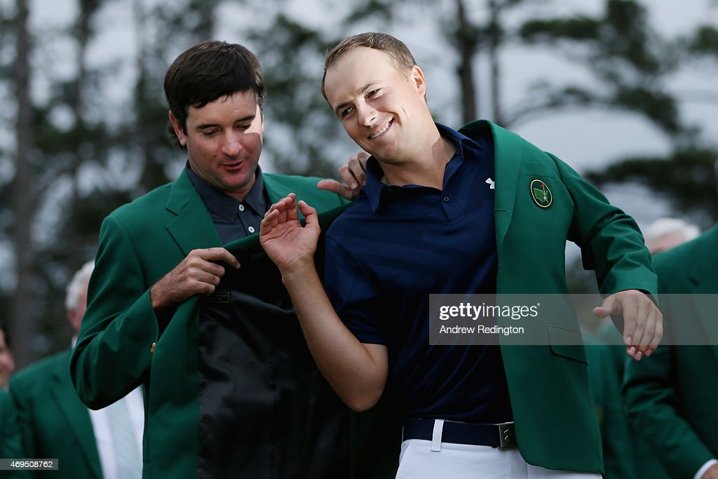 Bubba Watson presents Jordan Spieth of the United States with the green jacket after Spieth won the 2015 Masters Tournament at Augusta National Golf Club on April 12, 2015 in Augusta, Georgia.