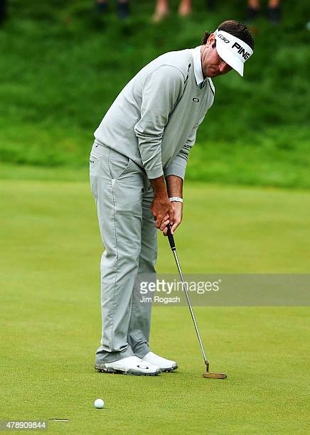 Bubba Watson putts on the 18th green to win during a playoff against Paul Casey of England during the final round of the Travelers Championship at...