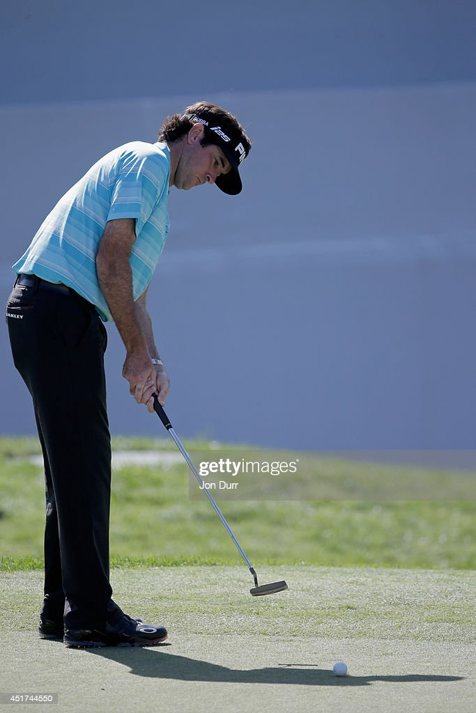 Bubba Watson putts on the 18th hole during the third round of the Greenbrier Classic at the Old White TPC on July 5, 2014 in White Sulphur Springs, West Virginia.