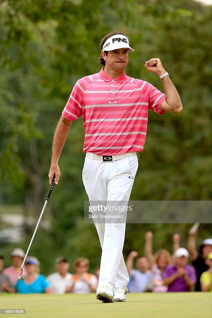 <a gi-track='captionPersonalityLinkClicked' href=/galleries/search?phrase=Bubba+Watson&family=editorial&specificpeople=597658 ng-click='$event.stopPropagation()'>Bubba Watson</a> reacts after a birdie putt on the 13th green during the final round of the World Golf Championships - Bridgestone Invitational at Firestone Country Club South Course on August 9, 2015 in Akron, Ohio.