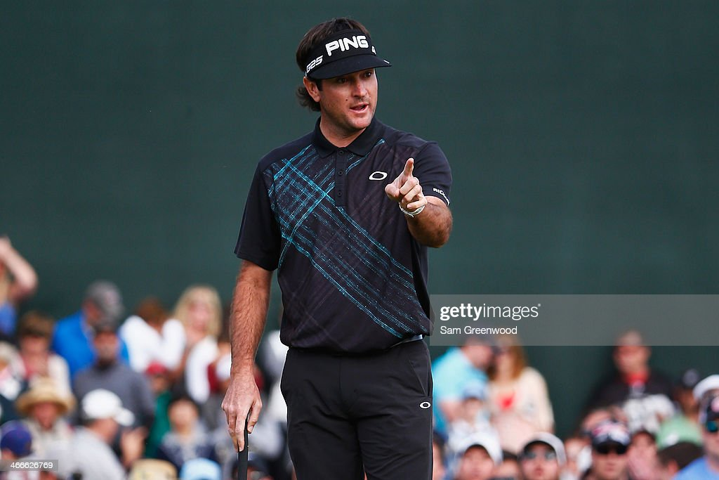 <a gi-track='captionPersonalityLinkClicked' href=/galleries/search?phrase=Bubba+Watson&family=editorial&specificpeople=597658 ng-click='$event.stopPropagation()'>Bubba Watson</a> reacts after missing a putt on the 18th hole during the final round of the Waste Management Phoenix Open at TPC Scottsdale on February 2, 2014 in Scottsdale, Arizona.