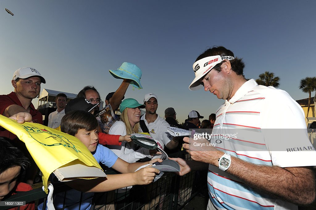 Bubba Watson signs autographs after the first round of the World Golf Championships-Cadillac Championship at TPC Blue Monster at Doral on March 7, 2013 in Doral, Florida.