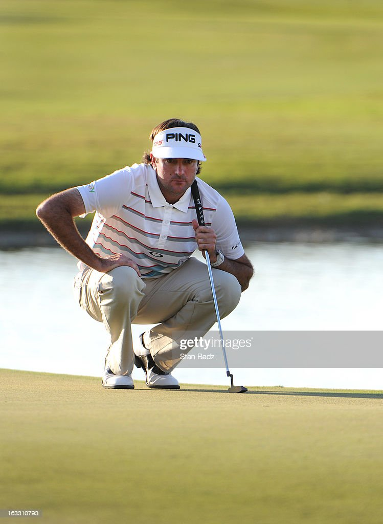 Bubba Watson studies his putt on the 18th green during the first round of the World Golf Championships-Cadillac Championship at TPC Blue Monster at Doral on March 7, 2013 in Doral, Florida.