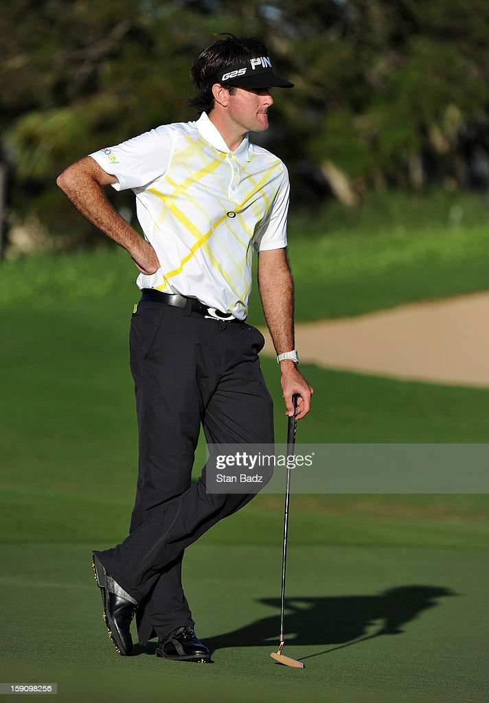 <a gi-track='captionPersonalityLinkClicked' href=/galleries/search?phrase=Bubba+Watson&family=editorial&specificpeople=597658 ng-click='$event.stopPropagation()'>Bubba Watson</a> watches play on the 17th green during the second round of the Hyundai Tournament of Champions at Plantation Course at Kapalua on January 7, 2013 in Kapalua, Maui, Hawaii.