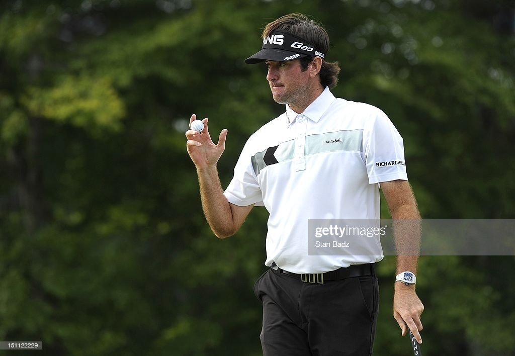 <a gi-track='captionPersonalityLinkClicked' href=/galleries/search?phrase=Bubba+Watson&family=editorial&specificpeople=597658 ng-click='$event.stopPropagation()'>Bubba Watson</a> waves his golf ball to the gallery on the 13th green during the second round of the Deutsche Bank Championship at TPC Boston on September 1, 2012 in Norton, Massachusetts.