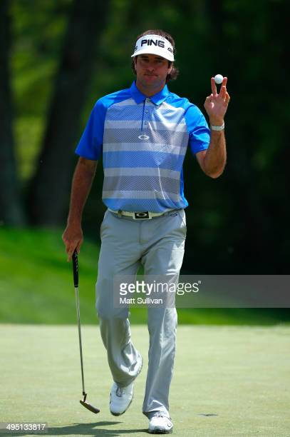 Bubba Watson waves to the gallery after making a birdie on the fourth hole during the final round of the Memorial Tournament presented by Nationwide...