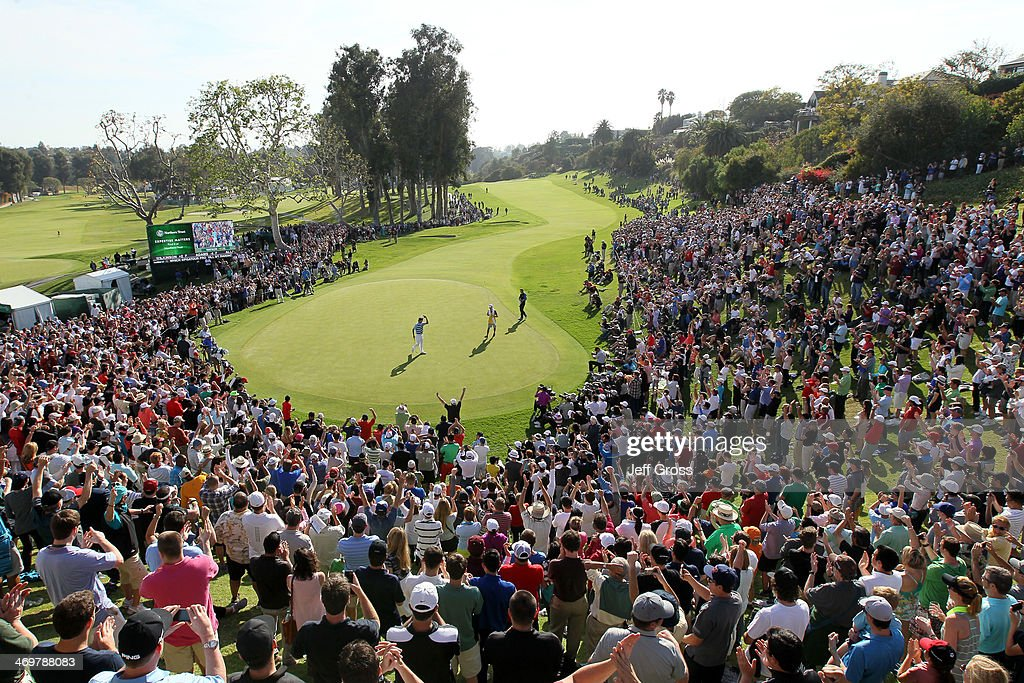 Bubba Watson waves to the gallery after sinking a birdie putt to win the Northern Trust Open at the Riviera Country Club on February 16, 2014 in Pacific Palisades, California.
