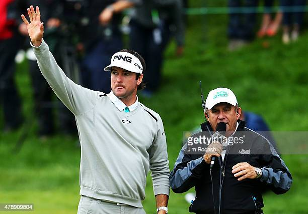 Bubba Watson wavews to the gallery after winning the final round of the Travelers Championship in a playoff against Paul Casey of England at TPC...