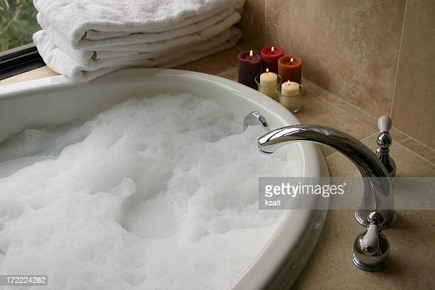 bubble bath with candles, towels