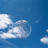 Bubble floating against blue sky (digital enhancement)