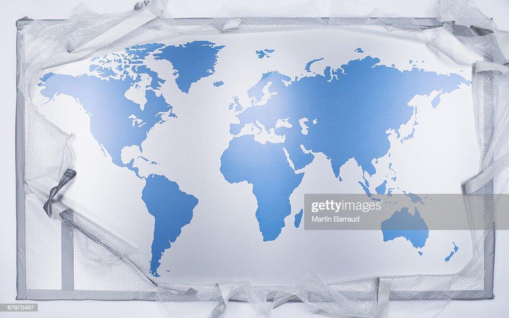Bubble wrap around world map : Stock Photo