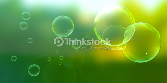 Bubbles blown outdoors on a sunny day : Stock Photo