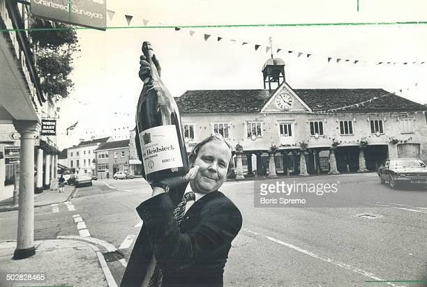 Bubbling over Insurance broker Jeremy Kahagan holds up a bottle of champagne that's likely to provide many a toast to the royal couple