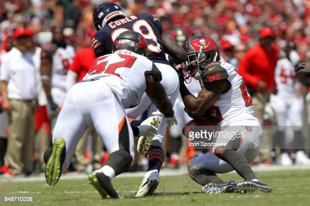 Buccaneers special teams captain Josh Robinson and Cameron Lynch strip the ball away from Tarik Cohen of the Bears during the NFL Regular game...