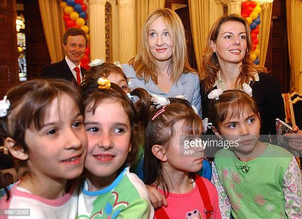 Britain's JK Rowling the author of the internationally bestselling series of books about the young wizard Harry Potter poses for with Romanian...