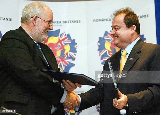 British Home Secretary Charles Clarke shakes hands with the Romanian Internal Affairs ministry Vasile Blaga as they signup of the memorandum in...