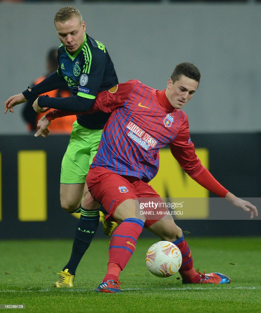 Bucharest's defender Florin Gardos (R) vies for the ball with Ajax Amsterdam's Icelandic forward Kolbeinn Sigthorsson during the UEFA Europa League Round of 32 football match FC Steaua Bucuresti vs AFC Ajax in Bucharest, Romania on February 21, 2013.