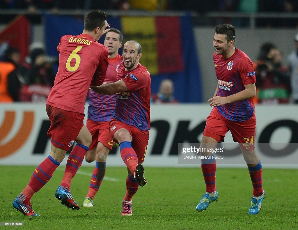 Bucharest's defender Iasmin Latovlevici (C) celebrates with his teammates after scoring the 1-0 during the UEFA Europa League Round of 32 football match FC Steaua Bucuresti vs AFC Ajax in Bucharest, Romania on February 21, 2013.