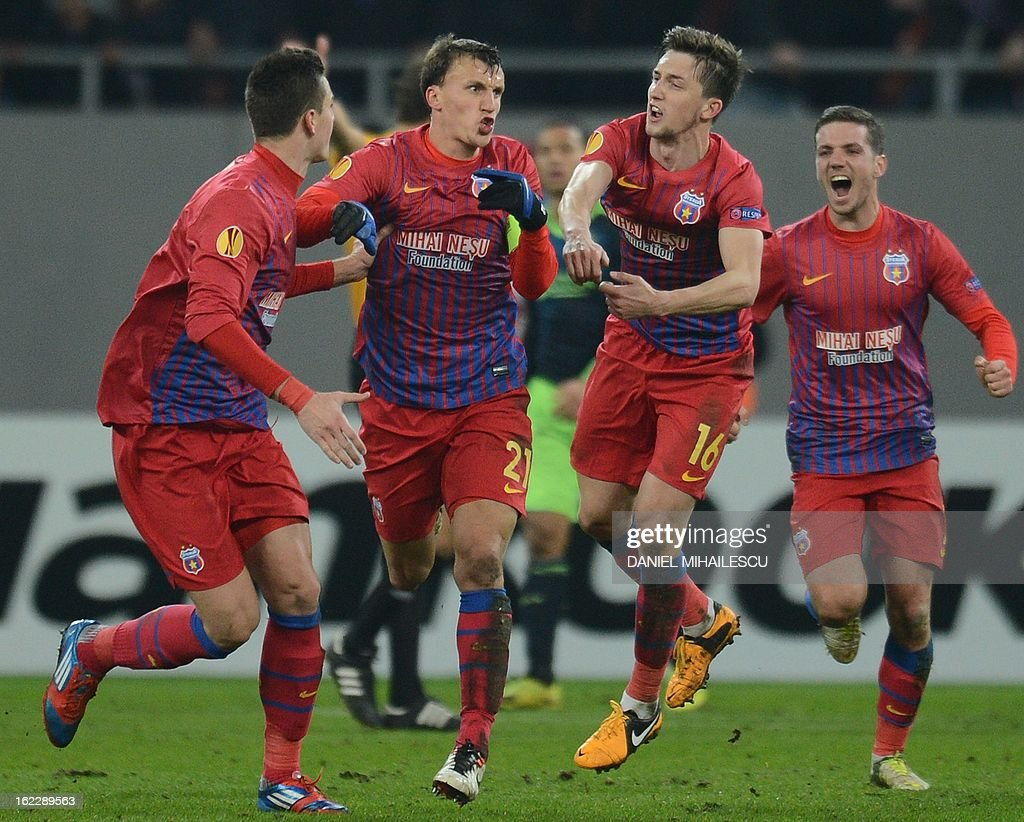 Bucharest's defender Vlad Chiriches (2nd L) celebrates with his teammates after scoring the 2-0 during the UEFA Europa League Round of 32 football match FC Steaua Bucuresti vs AFC Ajax in Bucharest, Romania on February 21, 2013.