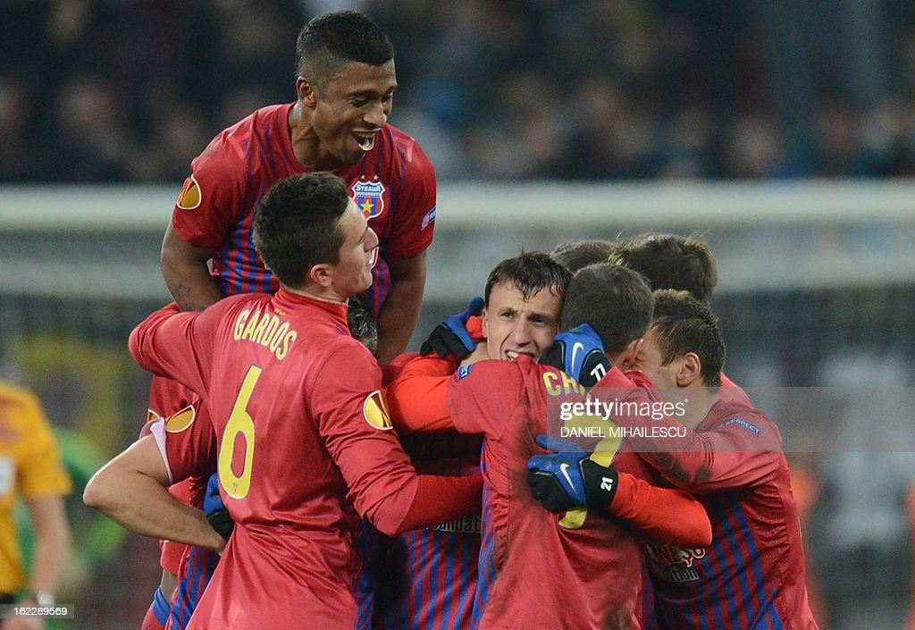 Bucharest's defender Vlad Chiriches (3rd L) celebrates with his teammates after scoring the 2-0 during the UEFA Europa League Round of 32 football match FC Steaua Bucuresti vs AFC Ajax in Bucharest, Romania on February 21, 2013.