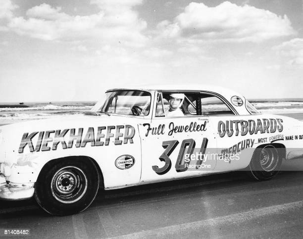 Buck Baker driver of the Karl Kiekhaefer Chrysler poses for a portrait in his car before the Daytona Beach and Road Course on February 26 1956 in...
