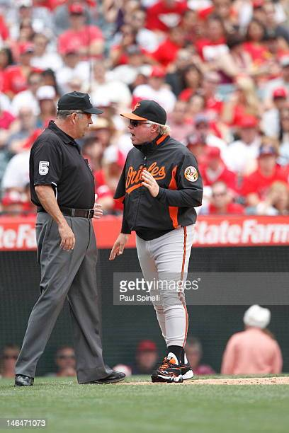 Buck Showalter manager of the Baltimore Orioles argues with second base umpire Dale Scott during the game against the Los Angeles Angels of Anaheim...