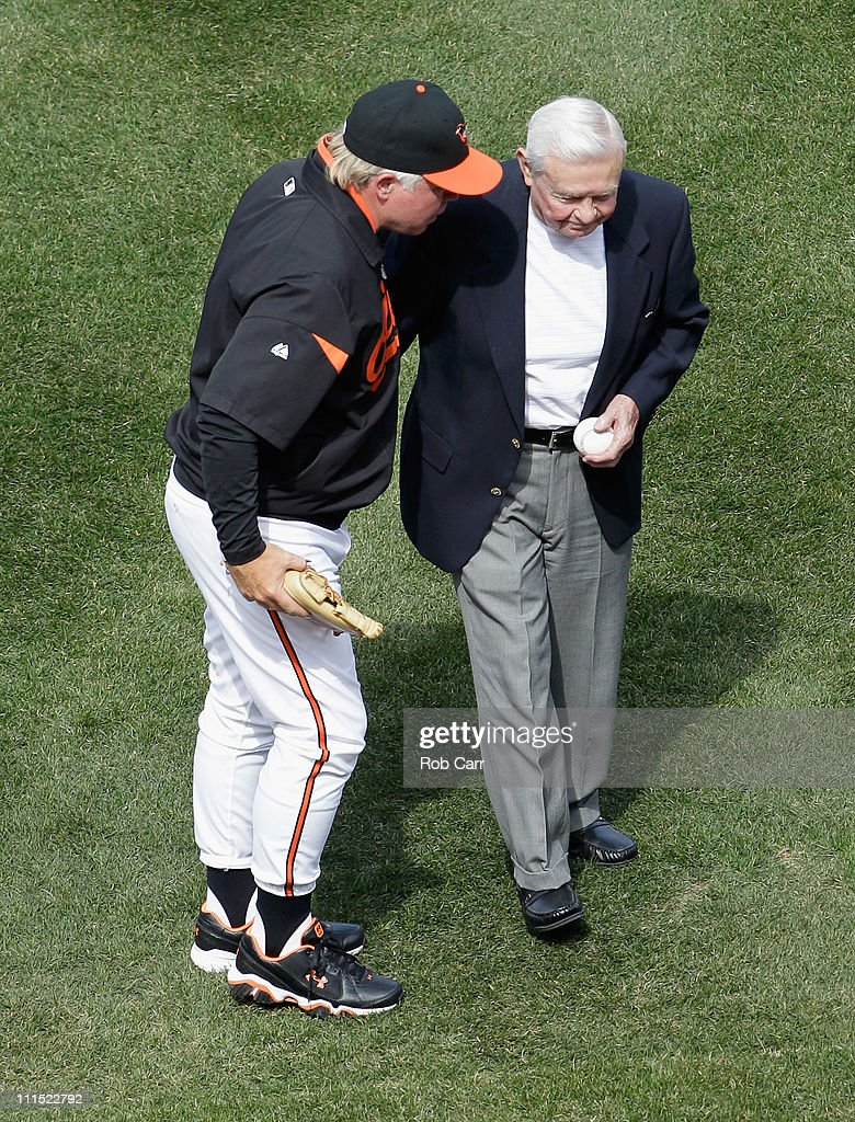 <a gi-track='captionPersonalityLinkClicked' href=/galleries/search?phrase=Buck+Showalter&family=editorial&specificpeople=208183 ng-click='$event.stopPropagation()'>Buck Showalter</a> #26 manager of the Baltimore Orioles talks with former Orioles manager <a gi-track='captionPersonalityLinkClicked' href=/galleries/search?phrase=Earl+Weaver&family=editorial&specificpeople=213180 ng-click='$event.stopPropagation()'>Earl Weaver</a> (R) after Weaver threw out the ceremonial first pitch before the start of their game against the Detroit Tigers during opening day at Oriole Park at Camden Yards on April 4, 2011 in Baltimore, Maryland.