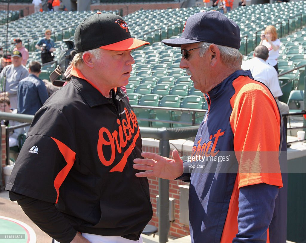 Buck Showalter #26 manager of the Baltimore Orioles (L) talks with Jim Leyland #10 manager of the Detroit Tigers (R) during opening day at Oriole Park at Camden Yards on April 4, 2011 in Baltimore, Maryland.