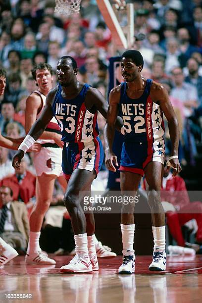 Buck Williams and Darryl Dawkins of the New Jersey Nets defend against the Portland Trail Blazers during a game played in 1986 at the Veterans...