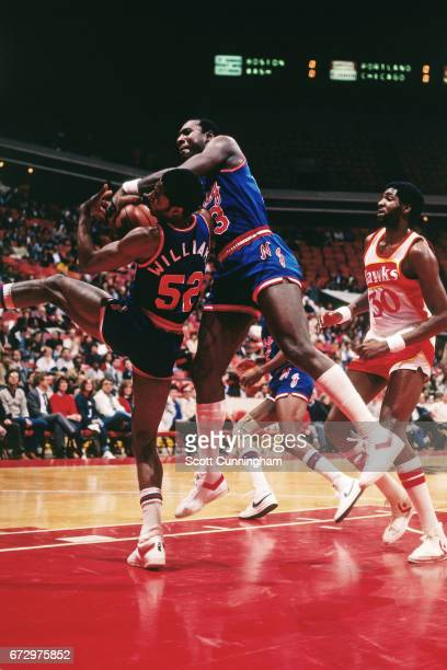 Buck Williams and Darryl Dawkins of the New Jersey Nets rebound against the Atlanta Hawks during a game played circa 1990 at the Omni in Atlanta...